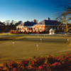 A view of the clubhouse with putting green in foreground from Signature at West Neck