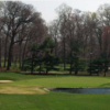 A view of a green protected by bunkers at Woodmont Country Club