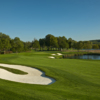 A view of the 2nd fairway with sand traps on both sides at Caves Valley Golf Club