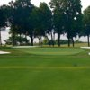 A view of a green surrounded by bunkers at Rocky Point Golf Course