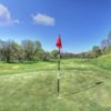 A warm spring day view of a hole and a fairway at River Downs Golf Club