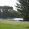 A view of a green with water in background at Greene Hills Golf Club