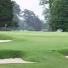 A view of a green protected by a collection of bunkers at Jefferson Lakeside Country Club