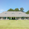 View of the puttin green and clubhouse at The Pines Golf Course at Fort Eustis