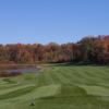 View of a green and fairway at Mountain Branch Golf Course