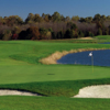 A view of a green with water coming into play at Regency At Dominion Valley Country Club