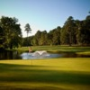 A view of a hole with a pond in background at Brandermill Country Club