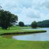 A view of a green surrounded by water at Clear Creek Golf Club.