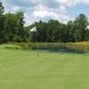 A view of a green with water coming into play Pendleton Golf Club.